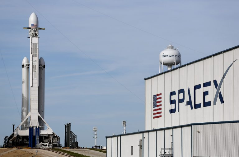 A Falcon 9 SpaceX heavy rocket stands ready for launch on pad 39A at the Kennedy Space Center in Cape Canaveral, Fla., Monday, Feb. 5, 2018. The Falcon Heavy scheduled to launch Tuesday afternoon, has three first-stage boosters, strapped together with 27 engines in all. (Terry Renna/AP Photo)