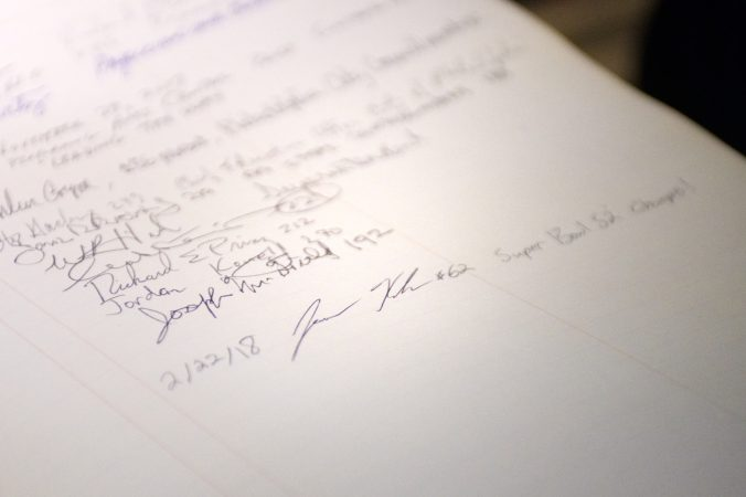 The signature of Philadelphia Eagles center Jason Kelce is the last entry in Central High's guestbook. The book dates back to 1838 and include two presidents as well as other notable alumni. (Bastiaan Slabbers/for WHYY)