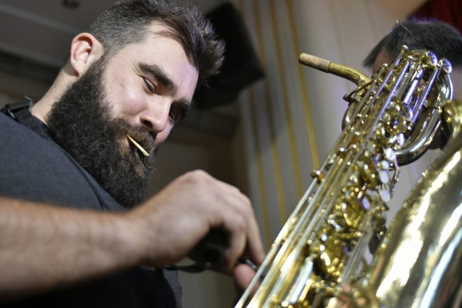 Philadelphia Eagles center, Cleveland Heights High School alumni, and former jazz band member Jason Kelce prepares the baritone sax he used to play, 12 years ago at his alma mater in Cleveland. (Bastiaan Slabbers/for WHYY)