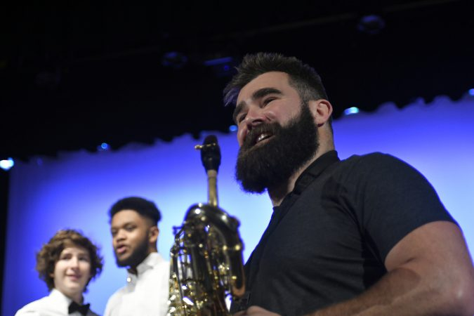 Super Bowl Champion and Philadelphia Eagles center Jason Kelce joins the jazz band of his alma mater, Cleveland Heights High School, on stage during a music exchange program visit at Central High School in Philadelphia, Pa. on Feb. 22, 2018. (Bastiaan Slabbers/for WHYY)