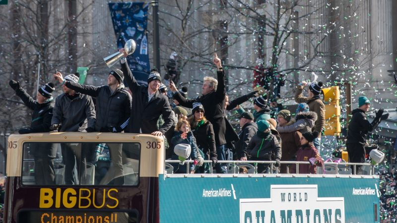 Philadelphia Eagles Players hold the Vince Lombardie Trophy during the teams celebratory parade through. (Branden Eastwood for WHYY)