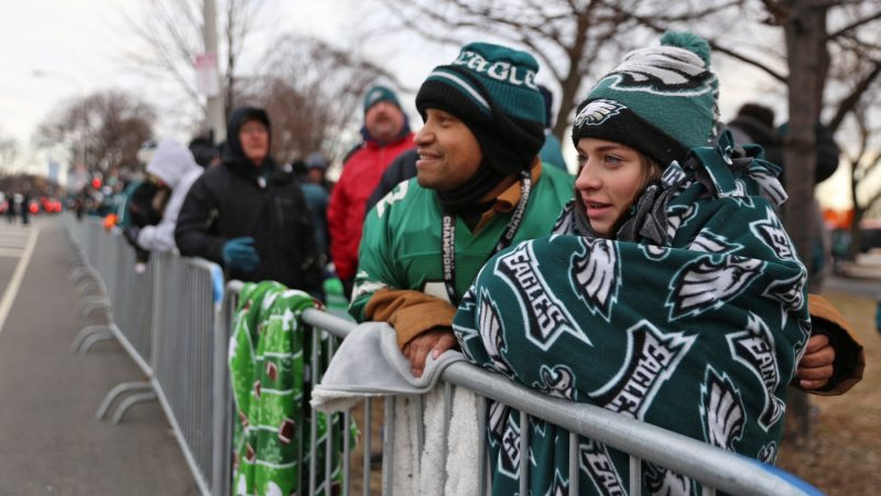 Juan Ramos and his niece, Kayla, from Allentown have been waiting for the parade since 4 a.m. He says the highlight of the Super Bowl was the Philly Special trick play for a touchdown. (Lindsay Lazarski/ WHYY)