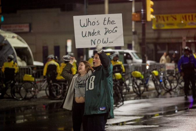 Eagles fans celebrate just before the end of regulation during Superbowl LII against the New England Patriots at Frankford and Cottman Avenue Sunday night. (Brad Larrison for WHYY)