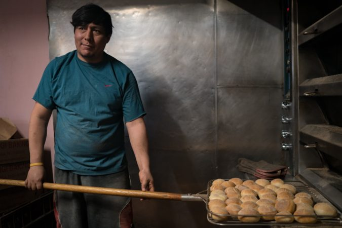 Carlos Garcia preps rolls at Carangi Baking Co. & Cafe in South Philadelphia in preparation for the Super Bowl on January 4, 2018.