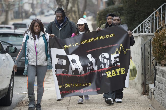 Davida Garner, center, and family members begin the Walk to End Homicide in the Oak Lane Section of the city.(Jonathan Wilson for WHYY)