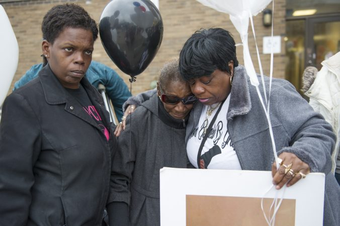 Irene Garner whose grandson Daymond Garner was gunned down in her home is comforted by Diane Williams who also lost her son, Howard Williams to gun violence.(Jonathan Wilson for WHYY)