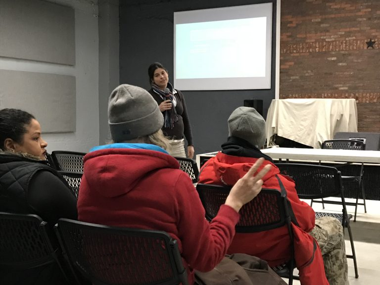 Amanda Fury listens to a resident's comment during a presentation on neighborhood conditions at a recent meeting of Somerset Neighbors for Better Living.