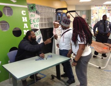 Fletcher Cox signed autographs for children and parents at A.I. DuPont children's hospital. (Zoë Read/WHYY)