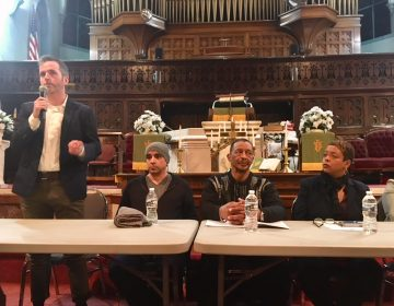 Philadelphia Inquirer columnist Mike Newall, far left, speaks at a community meeting about the prospect of the city hosting a safe-injection site. Seated next to him, left to right, are Gilberto Gonzales, Louis Cain, and City Councilwoman Cindy Bass. (Darryl Murphy/for WHYY)