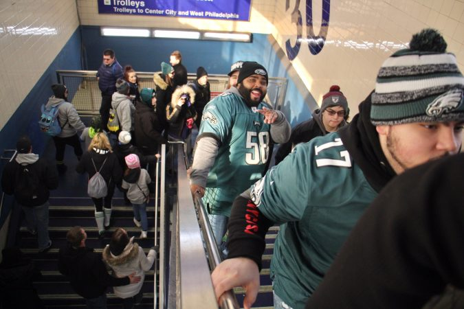 Happy Eagles fans arrive at 30th Street station on the Market Frankford line.