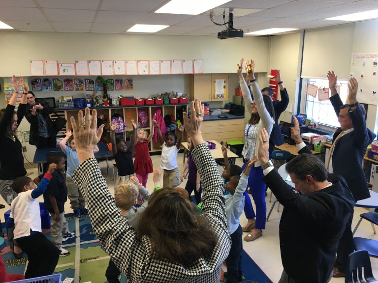 Gov. John Carney takes part in a mindfulness exercise with students at Mt. Pleasant Elementary School in Wilmington. (Mark Eichmann/WHYY)