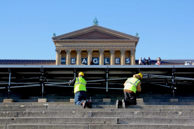 Workmen set up a stage in front of the Art Museum in preparation for the Eagles parade.