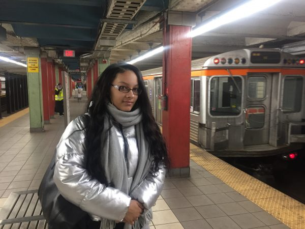 "Destiny Daye, 20, of North Philly, is waiting for the Broad Street Line to get to her job at Penn. Normally she'd transfer to the El at City Hall, but that's closed today. ""I'm happy the Eagles won, she says, ""but this is frustrating."" Her plan? Walk."
