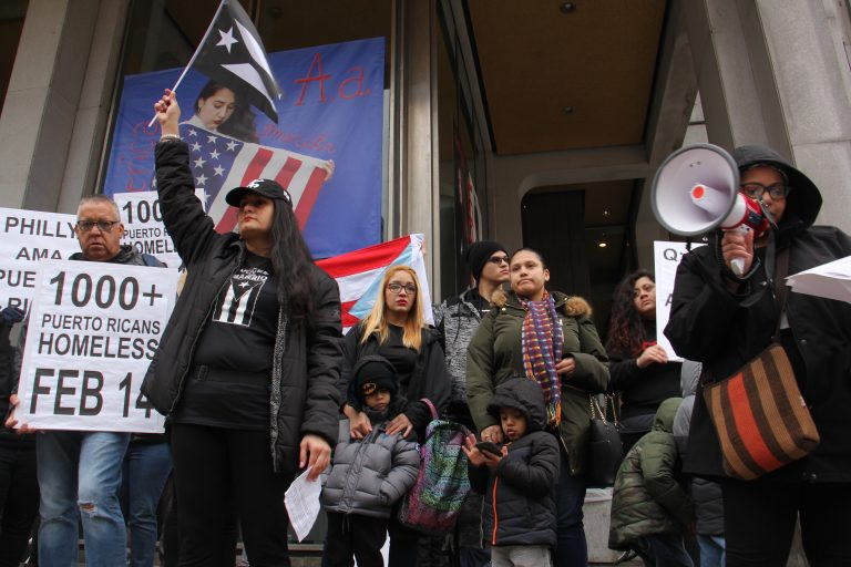 Activists call for more support for Puerto Ricans displaced by Hurricane Maria during a rally at Thomas Paine Plaza. They are joined by Carlos Torres (left), Muriel Rivera and her son, Yeriel, 6, (center left), and Melanie Garcia and her three children (center right), who all face eviction.
