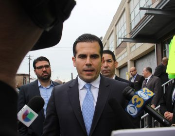 The governor of Puerto Rico Ricardo Rossello talks with reporters and demonstrators outside Esperanza College in North Philadelphia. Rossello said he would ask Gov. Tom Wolf make Pennsylvania a home state for Puerto Ricans displaced by Hurricane Maria, this making federal housing assistance available. (Emma Lee/WHYY)