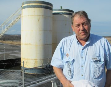 Jim Barrett stands next to a wellpad on his farm in Bradford County. He says Chesapeake Energy, which drilled four natural gas wells on his land, is cheating him out of royalty money. (Marie Cusick/StateImpact Pennsylvania)