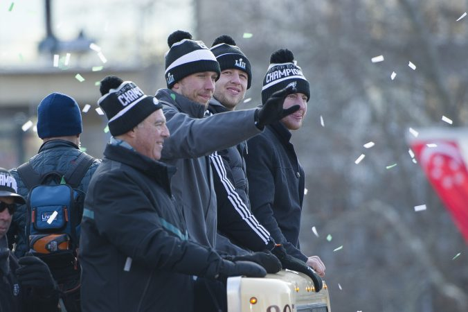 From left Eagles owner Jeff Lurie, quarterback, Nick Foles, backup quarterback Nate Sudfeld, and quarterback Carson Wentz. (Jonathan Wilson for WHYY)