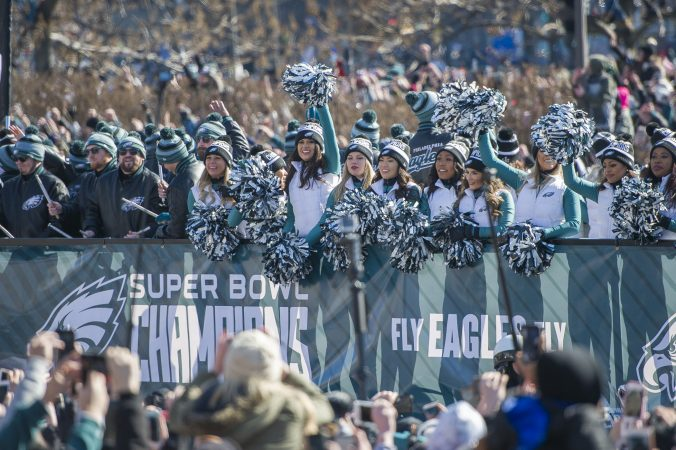 Eagles Cheerleaders wave to the crowd. (Jonathan Wilson for WHYY)