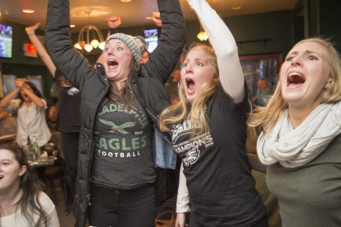 At Jon's Bar & Grille fans erupt as Eagles score a touchdown.