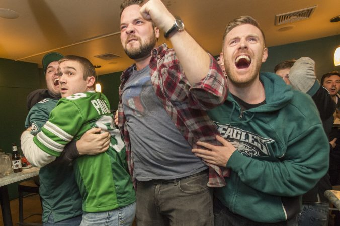 At Jon's Bar & Grille fans erupt as Eagles win the Super Bowl in the final seconds of the game.