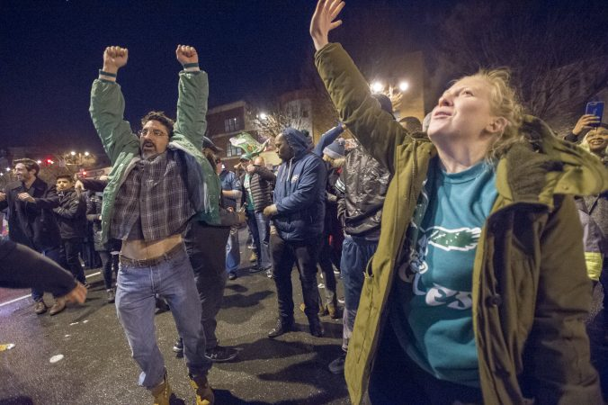 Fans cheer the Eagles at Broad and Kater Streets.