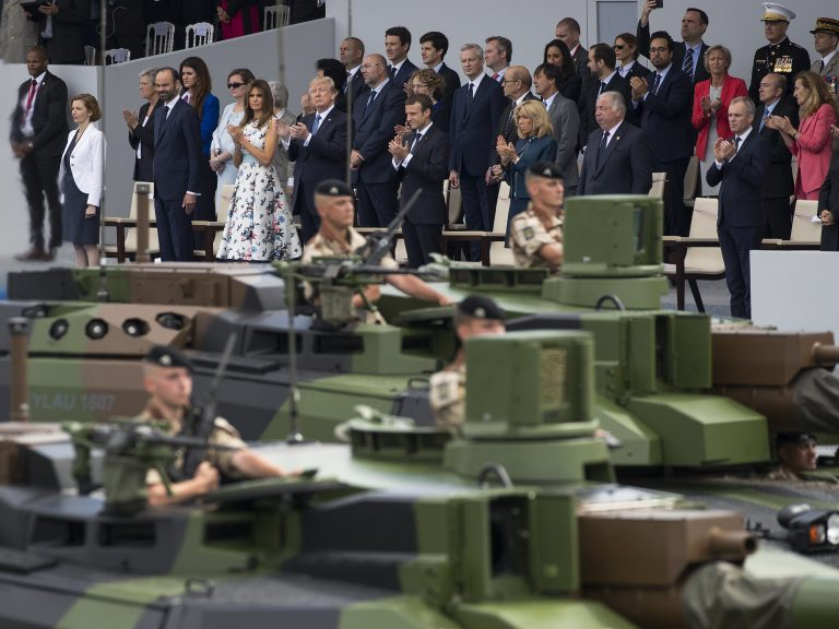 Tanks parade past President Trump, first lady Melania Trump, French President Emmanuel Macron and his wife Brigitte Macron, during a Bastille Day parade on the Champs Elysees avenue in Paris, on July 14.