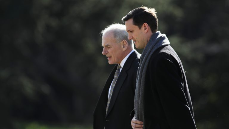 White House chief of staff John Kelly and staff secretary Rob Porter leave the White House Friday. Porter resigned following domestic abuse allegations.