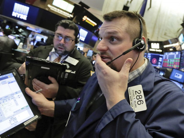 Trader Michael Milano (right) on the floor of the New York Stock Exchange on Thursday, a day when all the major U.S. stock indexes saw sharp drops.