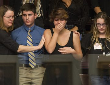 High school students from Parkland, Fla., where a young man gunned down 17 people, react as the state's House of Representatives voted not to hear a bill banning assault rifles. (Mark Wallheiser/AP)