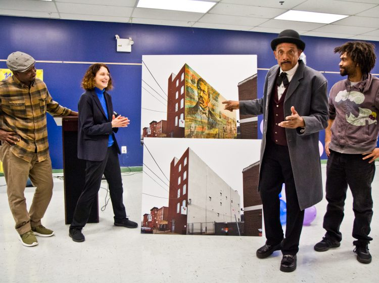 Artist Willis Nomo Humphrey, Executive Director of Mural Arts, Jane Golden, Octavius Catto re-enactor Bob Branch, and artist Keir Johnston unveil the mural honoring Octavius Catto to be installed at the Universal Institute Charter School on Catherine Street.(Kimberly Paynter/WHYY)