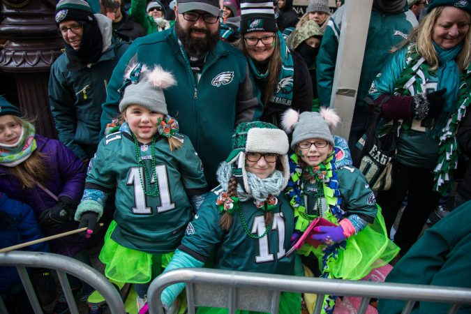 The Santora family stayed warm and festive as they waited to cheer on their winning Eagles for the Super Bowl Champions parade in Philadelphia February 8th 2018. (Emily Cohen for WHYY)