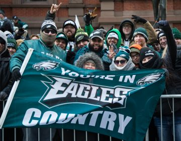 Friends from North Philadelphia faced the cold since 530am to get the best spot they could for the Eagles Super Bowl Champions parade in Philadelphia February 8th 2018. (Emily Cohen for WHYY)