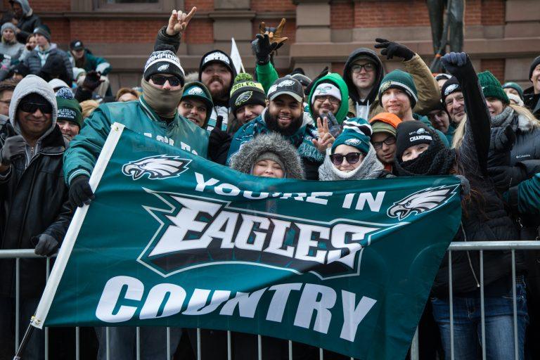 Friends from North Philadelphia faced the cold since 5:30 a.m. to get the best spot they could for the Eagles Super Bowl Champions parade in Philadelphia February 8th 2018. (Emily Cohen for WHYY)