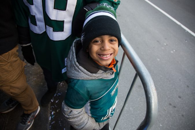 Ryan Smith,6, gets right up to the barricade to cheer on the winning Eagles for the Super Bowl Champions parade in Philadelphia February 8th 2018. (Emily Cohen for WHYY)