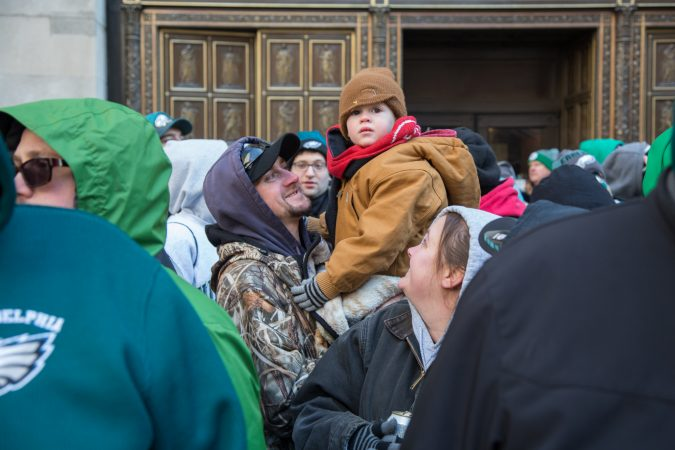 Fans young and old faced the freezing temperatures to cheer on their winning Eagles for the Super Bowl Champions parade in Philadelphia February 8th 2018. (Emily Cohen for WHYY)