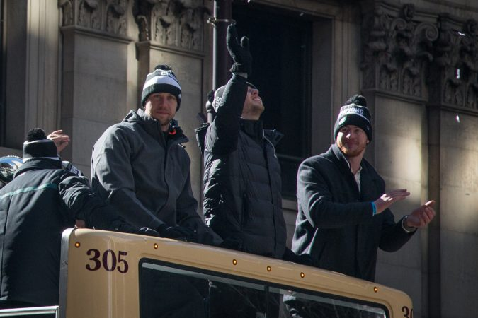 Eagles quartbacks Nick Foles and Carson Wentz smile and wave to their adoring fans at the Super Bowl Champions parade in Philadelphia February 8th 2018. (Emily Cohen for WHYY)