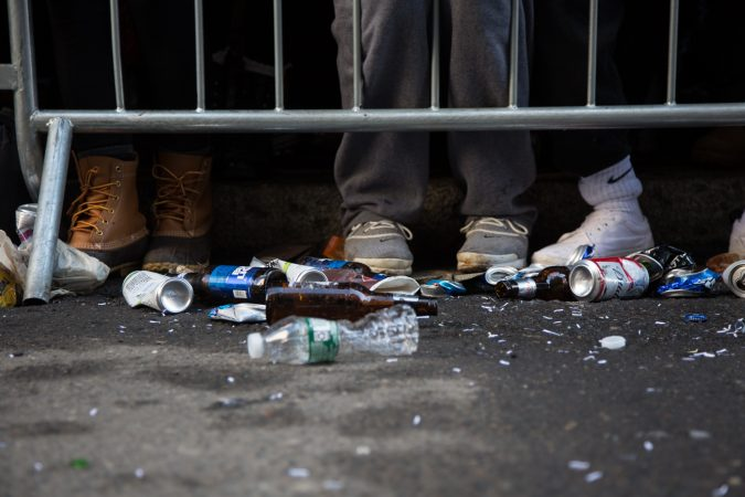 Beer bottles and cans litter the streets as fans begin and continue their early morning celebrations at the Eagles Super Bowl Champions parade in Philadelphia February 8th 2018. (Emily Cohen for WHYY)