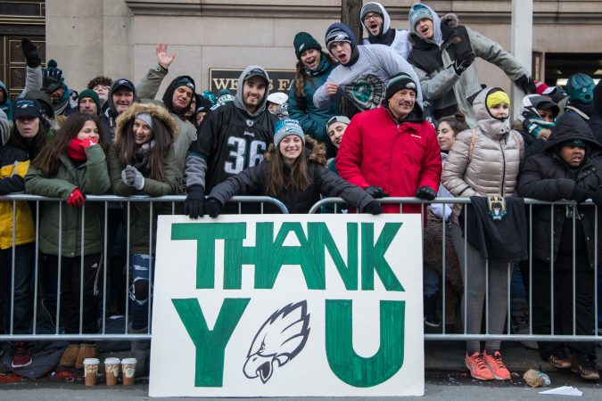 Alyssa Yates, 19, (center) holds her handmade sign at the Eagles Super Bowl Champions parade in Philadelphia February 8, 2018. (Emily Cohen for WHYY)