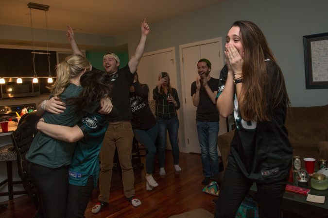 Rachel Miller (right) celebrates with friends after the Eagles score during the Super Bowl in Philadelphia February 4th 2018.