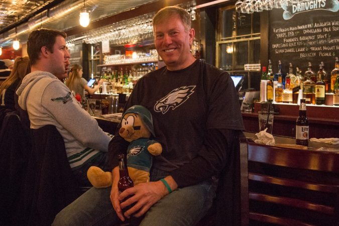 Bob Lamia, of Wayne, holds friend Jill's lucky bear Dougie before the start of the Super Bowl in Philadelphia February 4th 2018.