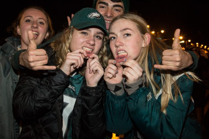 Fans show off their Eagles lip tattoos after the Eagles win the Super Bowl.