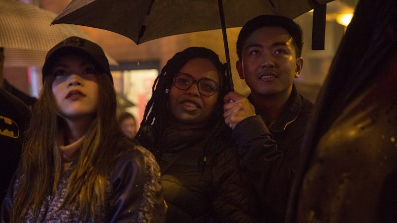 Revelers watch as very bright and very loud firecrackers are lit to celebrate the Chinese New Year in Phildelphia's Chinatown on February 15th 2018. (Emily Cohen for WHYY)
