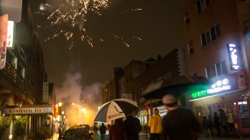 Fireworks are set off in celebration of the Chinese New Year in Phildelphia's Chinatown on February 15, 2018. (Emily Cohen for WHYY)