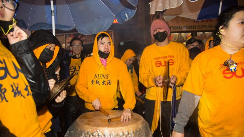 A drummer keeps the beat for the lions as they dance to celebrate the Chinese New Year in Phildelphia's Chinatown on February 15, 2018. (Emily Cohen for WHYY)
