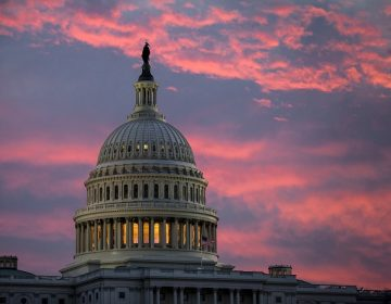 FILE - In this Thursday, Nov. 30, 2017, file photo, the sky over The Capitol is lit up at dawn  (AP Photo/J. Scott Applewhite, File)