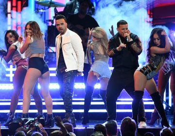 Luis Fonsi and Daddy Yankee, performing with female dancers during this year's Grammy telecast, is a topic on this week's show. (Kevin Winter/Getty Images for NARAS)