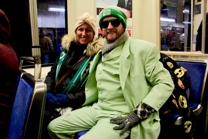 Sean Mundy, 32, of East Kensington, and his wife, Meghan Haley, 28, head to the Eagles Super Bowl parade in style on the Market Frankford line.
