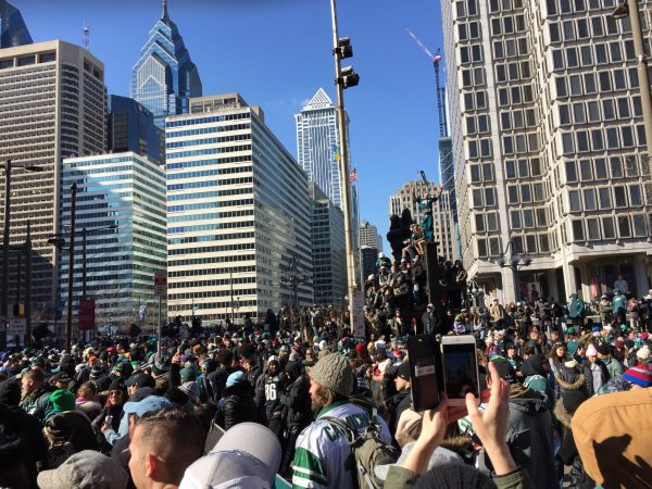 Eagles fans climb on everything.