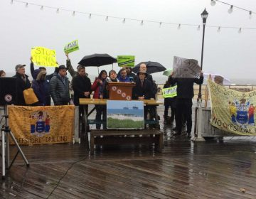 Environmentalists gather on Asbury Park's boardwalk to speak out against the Trump administration plan for expanded offshore drilling. (Phil Gregory/WHYY)