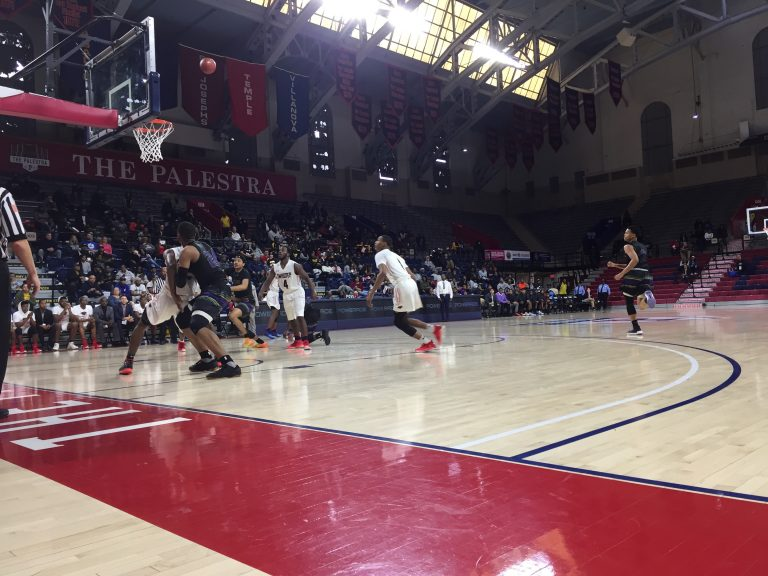 Imhotep Charter (white) and MLK High School (black) playing the city public league title game at the Palestra, February 25, 2018. (Avi Wolfman-Arent/WHYY)